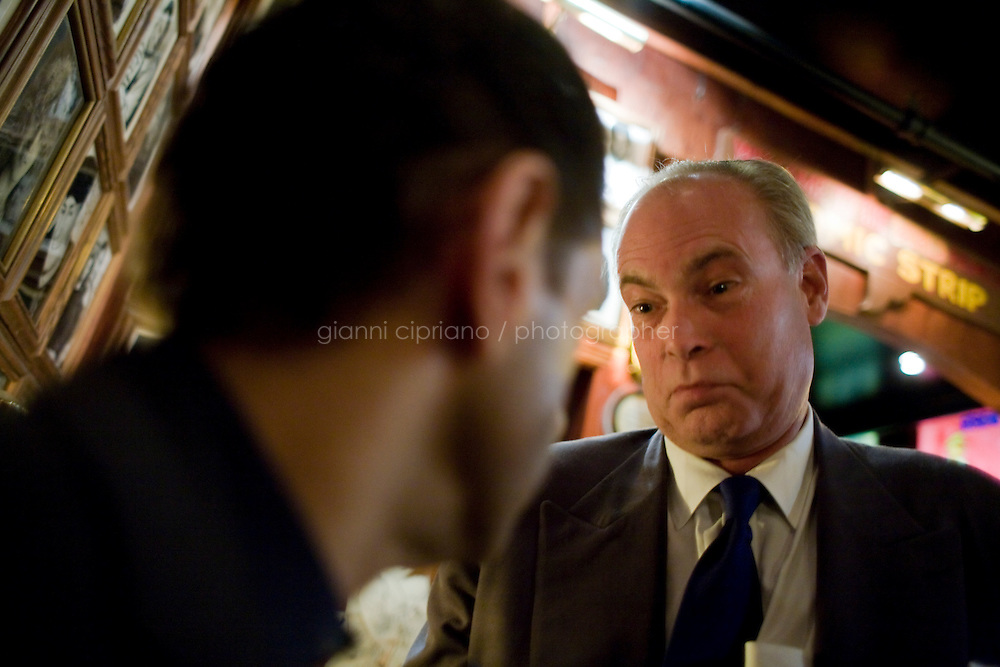8 October, 2008. New York, NY. Harry Hurt III (left), columnist of Executive Pursuits for The New York Times,  rehearses his comic script with comic and m.c. D.F. Sweedler (right) at the Comic Strip club in Manhattan, NY.  He will then go on stage in front of a live audience.  <br /> <br /> ©2008 Gianni Cipriano for The New York Times<br /> cell. +1 646 465 2168 (USA)<br /> cell. +1 328 567 7923 (Italy)<br /> gianni@giannicipriano.com<br /> www.giannicipriano.com