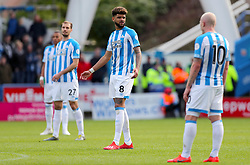 Huddersfield Town's Philip Billing (centre) appears dejected after his side concede during the Premier League match at the John Smith's Stadium, Huddersfield.