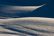 Abstract snow forms and shadows in Glacier Peak Wilderness, Cascade Range, Washington.