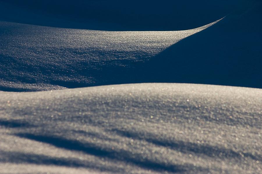 Abstract snow forms and shadows in Glacier Peak Wilderness, Cascade Range, Washington.