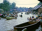 Floating market boats and sellers afloat on waterways near Bangkok, Thailand, Asia in 1964