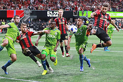 July 15, 2018 - Atlanta, GA, USA - Atlanta United midfielder Josef Martinez (right) triess to finish off a corner kick in front of the goal as Seattle Sounders' Jordy Delem defends during the second half on Sunday, July 15, 2018, in Atlanta, Ga. The teams battled to a 1-1 tie. Nouhou Tolo (left) defends against Leandro Gonzalez Perez on the play. (Credit Image: © Curtis Compton/TNS via ZUMA Wire)