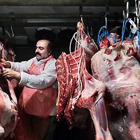 Nederland, Amsterdam , 3 november 2011..Slagerij Sera en de eigenaar Fikret Beydoğan. Beydoğan is twee weken geleden verkozen tot maatschappelijk vriendelijkste Turkse ondernemer en heeft de afgelopen zes jaar het meeste Offerfeest-vlees ingezameld voor de Amsterdamse voedselbanken. Hij is een gedreven ondernemer die erg geliefd is onder zijn klanten. Hij doet veel dingen voor de buurt..Butcher Sera of the owner Fikret Beydoğan. Beydoğan was  voted two weeks ago the best social Turkish entrepreneur and has raised most of the Feast of Sacrifice meat  for food banks in Amsterdam the last six years.