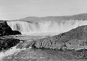 "9305-B7374. low-angle view of Celilo falls Original caption lettered on negative: ""No. 34. Celilo Falls on Columbia River. B. C. Markham, Portland, Ore."" 1927-1932."