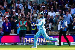 Jos Buttler of England celebrates after he helps to run out Martin Guptill of New Zealand to win the Cricket World Cup on the last ball of the Super Over - Mandatory by-line: Robbie Stephenson/JMP - 14/07/2019 - CRICKET - Lords - London, England - England v New Zealand - ICC Cricket World Cup 2019 - Final
