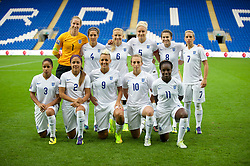 CARDIFF, WALES - Tuesday, August 21, 2014: England's players line up for a team group photograph before the FIFA Women's World Cup Canada 2015 Qualifying Group 6 match against Wales at the Cardiff City Stadium. Back row L-R: goalkeeper Karen Bardsley, Farah Williams, Laura Bassett, captain Steph Houghton, Karen Carney, Jordan Nobbs. Front row L-R: Demi Stokes, Alex Scott, Lianne Sanderson, Toni Duggan, Eniola Aluko. (Pic by Ian Cook/Propaganda)