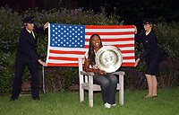 Serena Williams sits with the Womens Champions Plate as 2 sucurity guards hold the Stars and Stripes Flag. Wimbledon Tennis Championship, Day 12, 5/07/2003. Credit: Colorsport / Matthew Impey DIGITAL FILE ONLY