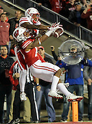 Wisconsin safety D'Cota Dixon, left, breaks up a pass intended for Nebraska wide receiver Stanley Morgan in the final play of the game during an NCAA college football game. Wisconsin beat Nebraska 23-17 in overtime. (AP Photo/Andy Manis)