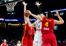 Rolands Smits of Latvia between Filip Barovic of Montenegro and Nikola Vucevic of Montenegro during basketball match between National Teams of Latvia and Montenegro at Day 11 in Round of 16 of the FIBA EuroBasket 2017 at Sinan Erdem Dome in Istanbul, Turkey on September 10, 2017. Photo by Vid Ponikvar / Sportida