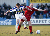 Photo: Chris Ratcliffe.<br />Colchester United v Southend United. Coca Cola League 1. 04/03/2006.<br />Adam Barrett (R) of Southend tussles with Tony Thorpe of Colchester.