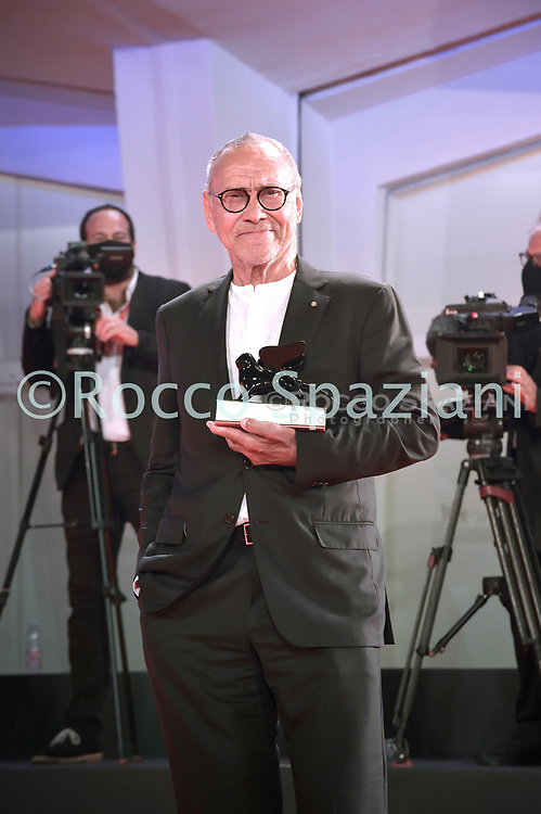 VENICE, ITALY - SEPTEMBER 12: Andrej Končalovskij poses with the Special Jury Prize during the winners photocall at the 77th Venice Film Festival on September 12, 2020 in Venice, Italy. <br /> (Photo by Rocco Spaziani)