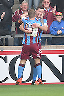 Tom Hopper of Scunthorpe United  celebrates with Gary McSheffrey of Scunthorpe United on the first goal for scunthorpe 1-0 up during the Sky Bet League 1 match between Scunthorpe United and Barnsley at Glanford Park, Scunthorpe, England on 31 October 2015. Photo by Ian Lyall.