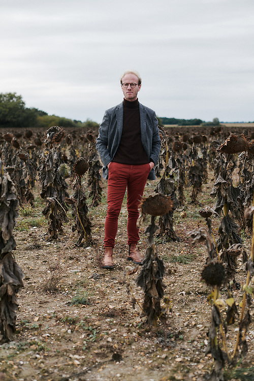 Xavier Desforges, posing in a sunflowers field. Dolus-le-Sec, France. October 7, 2019.