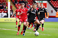 Barnsley forward Jacob Brown (33) beats Walsall FC defender Luke Leahy (3) to the ball during the EFL Sky Bet League 1 match between Walsall and Barnsley at the Banks's Stadium, Walsall, England on 23 March 2019.