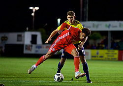 RHYL, WALES - Wednesday, November 14, 2018: Wales' Christian Norton and Scotland's Robbie Deas during the UEFA Under-19 Championship 2019 Qualifying Group 4 match between Wales and Scotland at Belle Vue. (Pic by Paul Greenwood/Propaganda)
