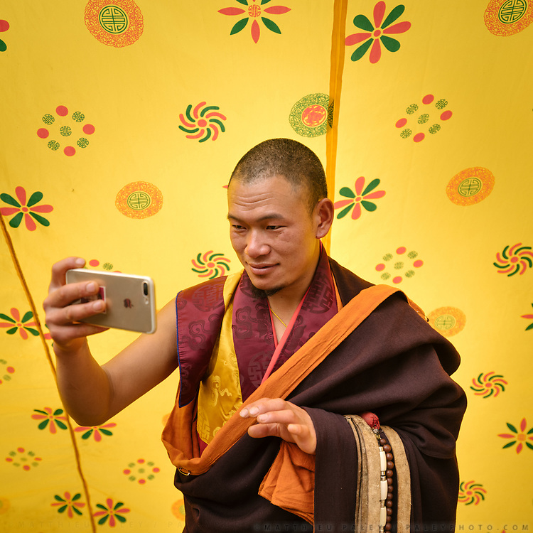Head monk doing a selfie. The Tshechu of the Gasa monastery on the road leading to Laya. Tshechu are annual religious Bhutanese festivals held in each district on the tenth day of a month of the lunar Tibetan calendar. Tshechus are large social gatherings, which perform the function of social bonding among people of remote and spread-out villages.