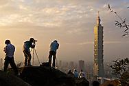 Photographers photograph Taipei 101 and the Taipei City skyline from Elephant Mountain, Taipei, Taiwan.