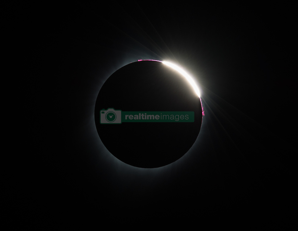 Some prominences are seen as the moon begins to move off the sun during the total solar eclipse on Monday, August 21, 2017 above Madras, Oregon. A total solar eclipse swept across a narrow portion of the contiguous United States from Lincoln Beach, Oregon to Charleston, South Carolina. A partial solar eclipse was visible across the entire North American continent along with parts of South America, Africa, and Europe.  Photo Credit: (NASA/Aubrey Gemignani)
