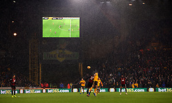 Action on the pitch as the rain falls during the Premier League match at Molineux, Wolverhampton.