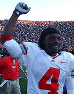 MORNING JOURNAL/DAVID RICHARD.Santonio Holmes pumps his fist after Ohio State's win over Michigan..