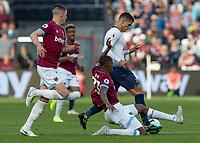 Football - 2018 / 2019 Premier League - West Ham United vs. Tottenham Hotspur<br /> <br /> Issa Diop (West Ham United) stretches to reach Erik Lamela (Tottenham FC)  before he breaks away at the London Stadium<br /> <br /> COLORSPORT/DANIEL BEARHAM