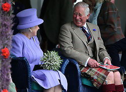 Embargoed to 0001 Wednesday December 28 File photo dated 03/09/16 of Queen Elizabeth II, accompanied by the Prince of Wales, also known as the Duke of Rothesay when in Scotland, at the Braemar Royal Highland Gathering at the Princess Royal and Duke of Fife Memorial Park, Braemar.