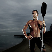 GOLD COAST, AUSTRALIA - OCTOBER 06:  (EDITORS NOTE: Image has been desaturated.) Australian ironman champion Zane Holmes poses for a portrait at Tallebudgera Creek on October 6, 2011 in Gold Coast, Australia.  (Photo by Chris Hyde/Getty Images) *** Local Caption *** Zane Holmes