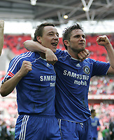 Photo: Lee Earle.<br /> Chelsea v Manchester United. The FA Cup Final. 19/05/2007.Chelsea's John Terry (L) and Frank Lampard celebrate.