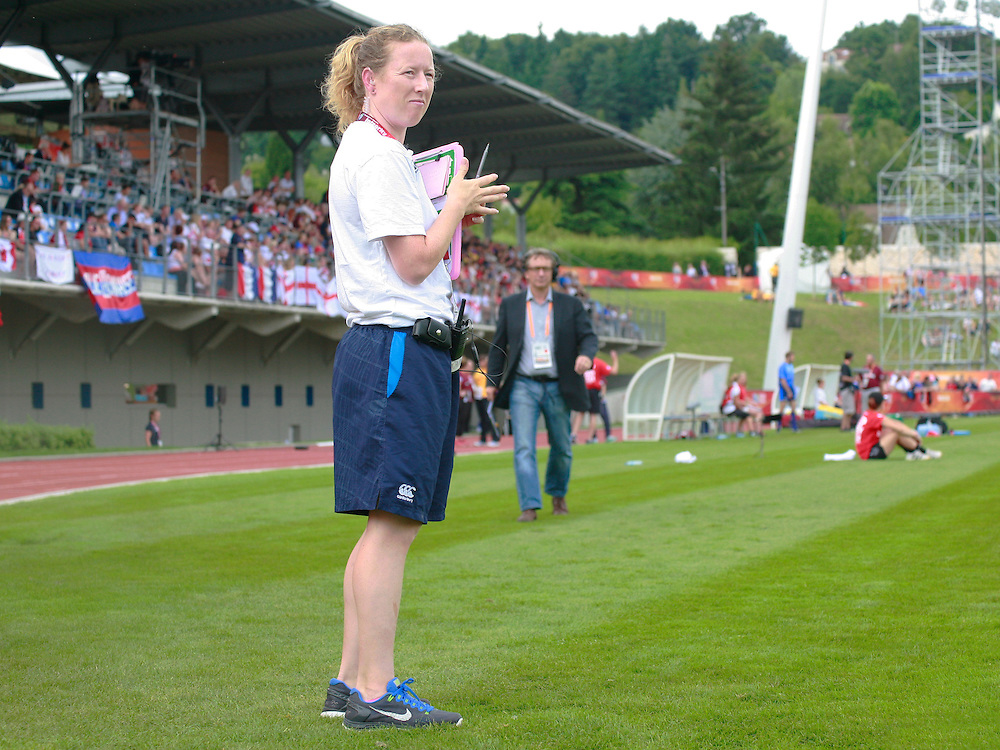 Janette Shaw watches over the substitutes warming up. England v Canada Pool A match at WRWC 2014 at Centre National de Rugby, Marcoussis, France, on 9th August 2014