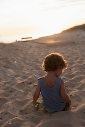 Rear view of a boy playing on the beach during sunset, Lit-et-Mixe, Aquitaine, France
