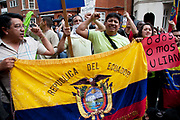 London, UK. Thursday 16th August 2012. Supporters of Julian Assange shout in protest with their flag outside the Ecuador Embassy.