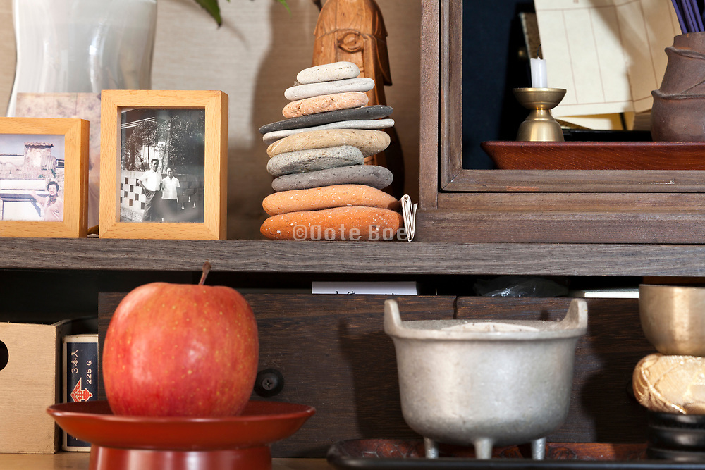 at home family memory shrine with offerings Japan