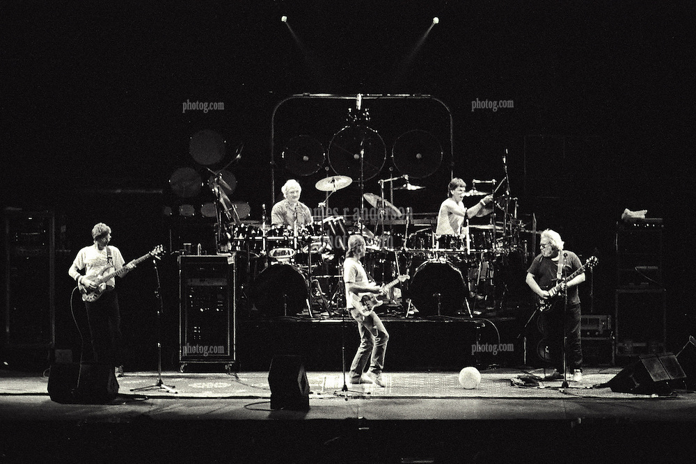 The Grateful Dead in Concert at Madison Square Garden, New York, NY. 15 September 1988. B&W Tri-X film original photograph shot from the Lighting Booth, center floor.