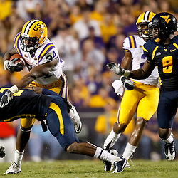 Sep 25, 2010; Baton Rouge, LA, USA; West Virginia Mountaineers cornerback Robert Sands (2) dives in front of LSU Tigers running back Stevan Ridley (34)during the second half at Tiger Stadium. LSU defeated West Virginia 20-14.  Mandatory Credit: Derick E. Hingle