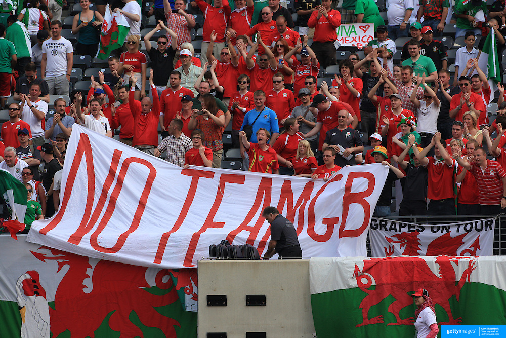 Welsh fans holding a 'No team GB' sign during the Mexico V Wales international football friendly match at MetLife Stadium, East Rutherford, New Jersey, 23rd May 2012. Photo Tim Clayton