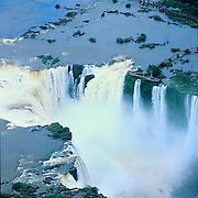 South America, Brazil, Argentina, Igwazu Falls. Igwacu Falls thunder into the Igwacu River below.