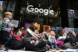 © Licensed to London News Pictures. 16/10/2019. London, UK. Extinction Rebellion activists block the entrance to Google UK headquarters in Kings Cross London, demanding accountability from the Internet giant when representationing of climate change on their Youtube platform. Photo credit: Guilhem Baker/LNP