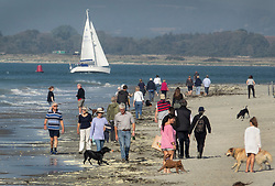 © Licensed to London News Pictures. 10/10/2018. West Wittering, UK. Visitors to West Wittering enjoy the sunshine on the beach during a day of unseasonably high temperatures. Photo credit: Peter Macdiarmid/LNP