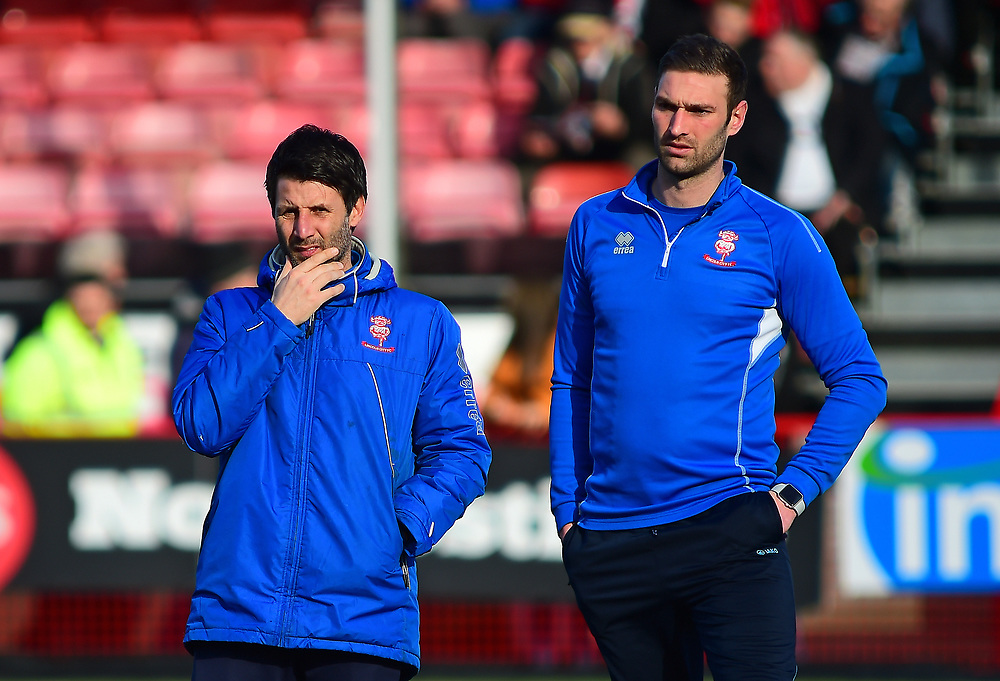 Lincoln City manager Danny Cowley, left, and Lincoln City's first team coach/under 23 manager Jamie McCombe during the pre-match warm-up<br /> <br /> Photographer Andrew Vaughan/CameraSport<br /> <br /> The EFL Sky Bet League Two - Crawley Town v Lincoln City - Saturday 17th February 2018 - Broadfield Stadium - Crawley<br /> <br /> World Copyright © 2018 CameraSport. All rights reserved. 43 Linden Ave. Countesthorpe. Leicester. England. LE8 5PG - Tel: +44 (0) 116 277 4147 - admin@camerasport.com - www.camerasport.com