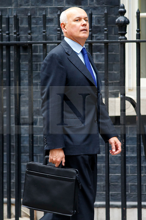 © Licensed to London News Pictures. 14/07/2015. London, UK. Work & Pensions Secretary, Iain Duncan Smith attending to a cabinet meeting in Downing Street on Tuesday, July 14, 2015. Photo credit: Tolga Akmen/LNP