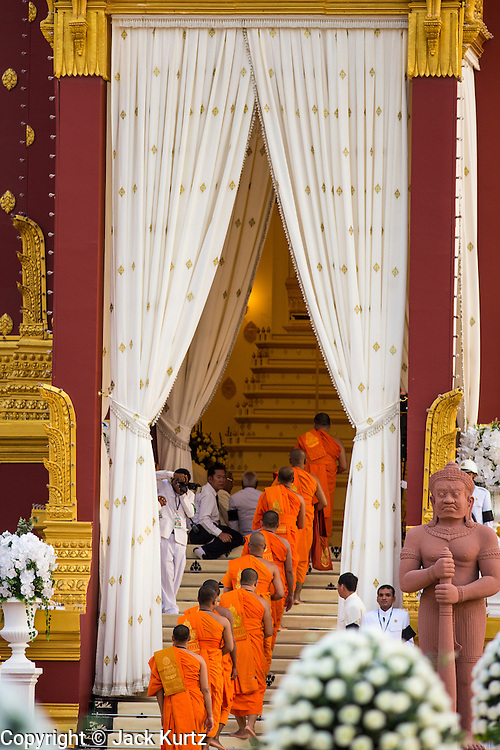 """03 FEBRUARY 2013 - PHNOM PENH, CAMBODIA:   Buddhist monks file into the crematorium for the final Buddhist chanting service for former Cambodian King Norodom Sihanouk in the crematorium built for the King's funeral at the National Museum in Phnom Penh. Norodom Sihanouk (31 October 1922- 15 October 2012) was the King of Cambodia from 1941 to 1955 and again from 1993 to 2004. He was the effective ruler of Cambodia from 1953 to 1970. After his second abdication in 2004, he was given the honorific of """"The King-Father of Cambodia."""" He served as puppet head of state for the Khmer Rouge government in 1975-1976, before going into exile. Sihanouk's actual period of effective rule over Cambodia was from 9 November 1953, when Cambodia gained its independence from France, until 18 March 1970, when General Lon Nol and the National Assembly deposed him. Upon his final abdication in 2004, the Cambodian throne council appointed Norodom Sihamoni, one of Sihanouk's sons, as the new king. Sihanouk died in Beijing, China, where he was receiving medical care, on Oct. 15, 2012. His cremation will take place on Feb. 4, 2013. Over a million people are expected to attend the service.   PHOTO BY JACK KURTZ"""