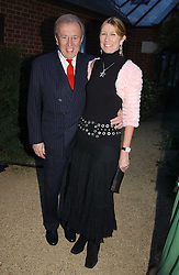 SIR DAVID & LADY CARINA FROST at the Cartier Chelsea Flower Show dinat the annual Cartier Flower Show Diner held at The Physics Garden, Chelsea, London on 23rd May 2005.<br /><br />NON EXCLUSIVE - WORLD RIGHTS