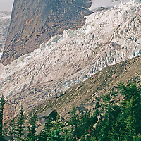 BRITISH COLUMBIA, CANADA. Bugaboo Glacier flows around the Hound's Tooth in Purcell Mountains, Bugaboo Provincial Park.