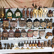 A stall of tourist souvenirs for sale just outside the entrance of Gu-byauk-gyi Temple in Nyaung-U, Myanmar (Burma).