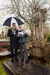 Janet Worrall Secretary of the the Friends of Boston Castle Parkland and Mooregate Cemetery shows the current Mayor of Rotherham, Cllr Shaun Wright, Sir Charles Stoddart's grave. Three times Mayor of Rotherham he Commissioned and Gifted the towns Mace to Rotherham...120627 Mayor tours Mooregate Cemetery..120627 Mayor tours Mooregate Cemetery..http://www.pauldaviddrabble.co.uk.18 April 2012 .Image © Paul David Drabble