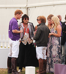 Asprey World Class Cup polo held at Hurtwood Park Polo Club, Ewhurst, Surrey on 17th July 2010.<br /> Picture shows:- PRINCE HARRY, RONNIE WOOD and KENNEY JONES