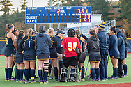 Pleasantville, New York - Pace University field hockey players and coaches meet on the field before the start of the overtime period of a  Northeast-10 Conference field hockey playoff game on Oct. 31, 2017.