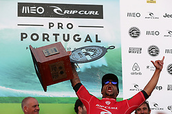 October 20, 2018 - Peniche, Portugal - Italo Ferreira of Brazil raises the trophy after winning the World Surf League MEO Rip Curl Pro Portugal, the 10th event of the WSL Men's Championship Tour, at the Supertubos beach in Peniche, Portugal, on October 20, 2018. (Credit Image: © Pedro Fiuza/ZUMA Wire)
