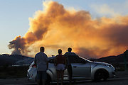 People watch a wildfire in Lytle Creek, Calif., Tuesday, Aug. 16, 2016. AFP PHOTO / Ringo Chiu
