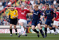 Photo: Leigh Quinnell.<br /> Bristol City v Nottingham Forest. Coca Cola League 1. 31/03/2007. Bristol Citys Steve Brooker gets past Forests Gary Holt.